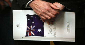 A person holds a copy of Australia's citizenship test.
