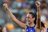 Brisbane Lions AFLW players smile and wave to fans at the Gabba.