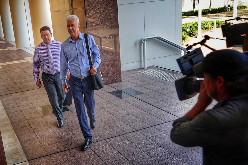 John McRoberts and his lawyer enter the NT Supreme Court.