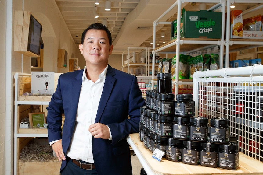 AuMake chairman Keong Chan stands in a retail store.