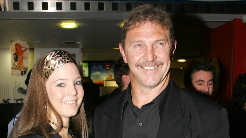 Brett Kenny poses with a woman at a cinema.