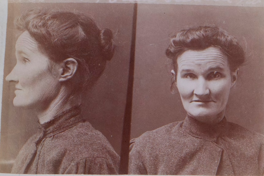 A faded sepia prison photo depicting a middle-aged woman.