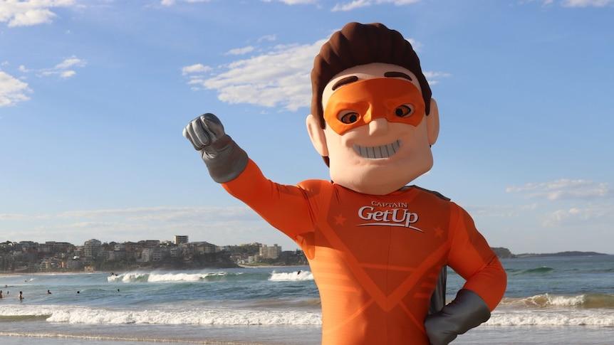 Satirical superhero Captain GetUp on a beach.
