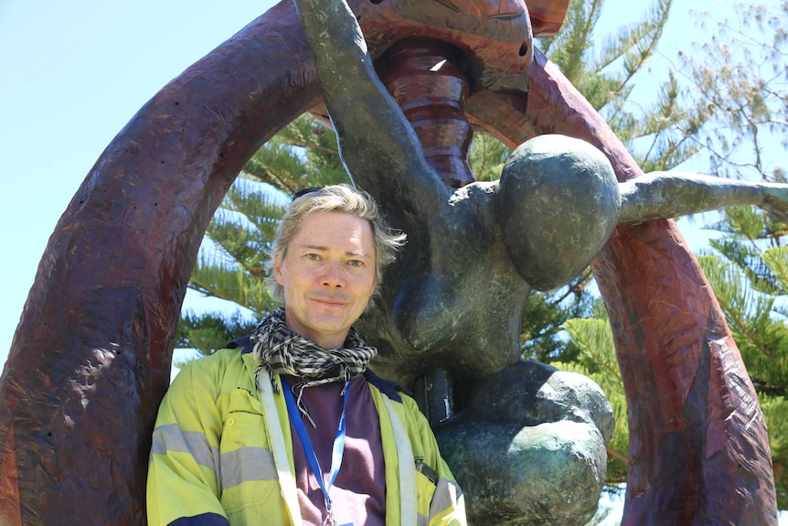 """Toby Bell stands in front of his 700 kilogram sculpture, """"The Cosmic Blacksmith""""."""