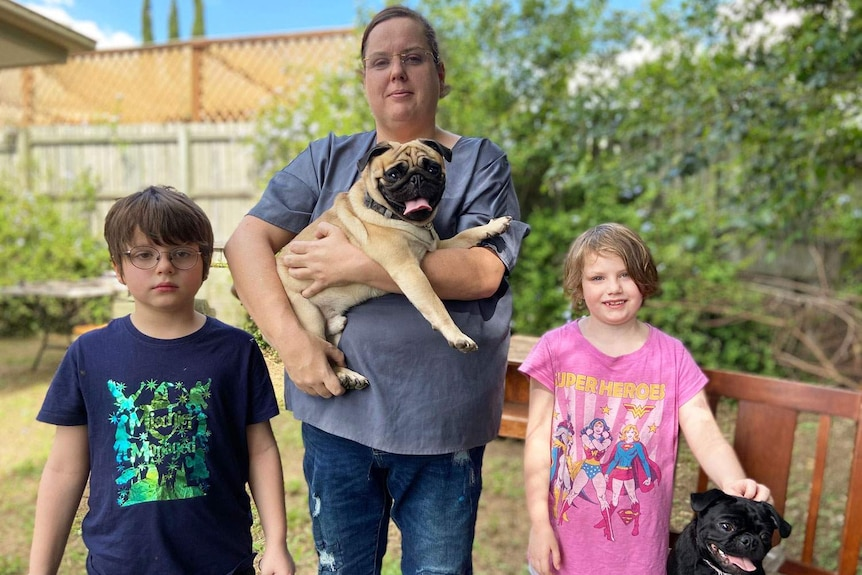 Mum Cassie Windsor with son Zeike and daughter Mysan, and their two dogs.