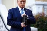 Donald Trump holding a bible