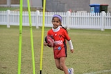 Young Auslan Aussie rules player playing