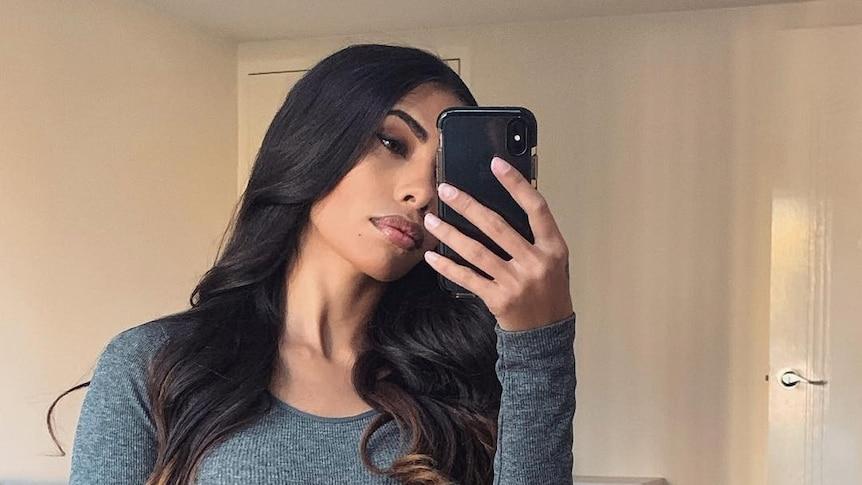A mirror selfie taken by a woman