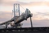 Coal coming off a conveyer belt at a mine