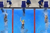 Simone Manuel of the United States touches the wall to win gold in the women's 100m freestyle final.