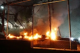A fire burns at the Moria migrant detention camp on the Greek island of Lesbos, following clashes between migrants and refugees