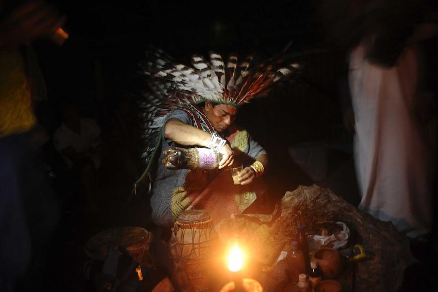 A Huni Kui Indian prepares Ayahuasca