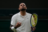 Nick Kyrgios grimaces with his eyes closed after a point during his first-round Wimbledon match.