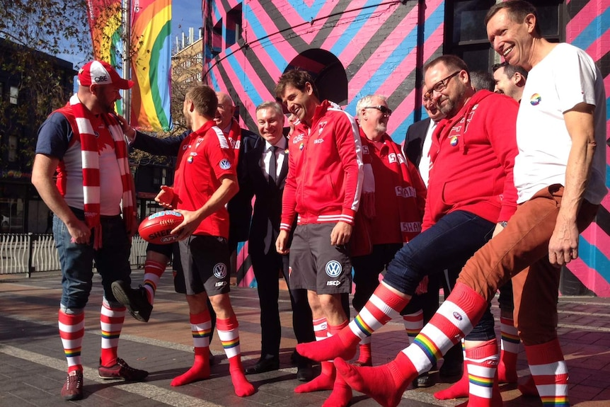 Sydney Swans players and supporters prepare for the first pride match