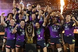 Melbourne Storm celebrate with the premiership trophy