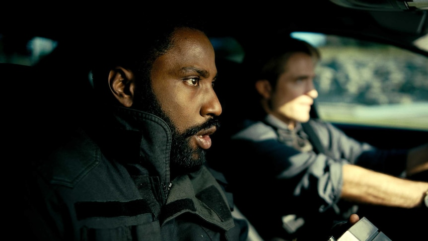 John David Washington and Robert Pattinson confront each other in a scene from the film Tenet