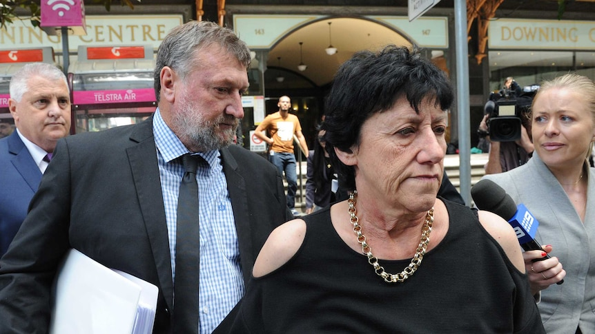 Greg and Virginia Hughes leave the last day of the coronial inquiry into their son's death.