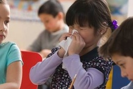child sneezing at school