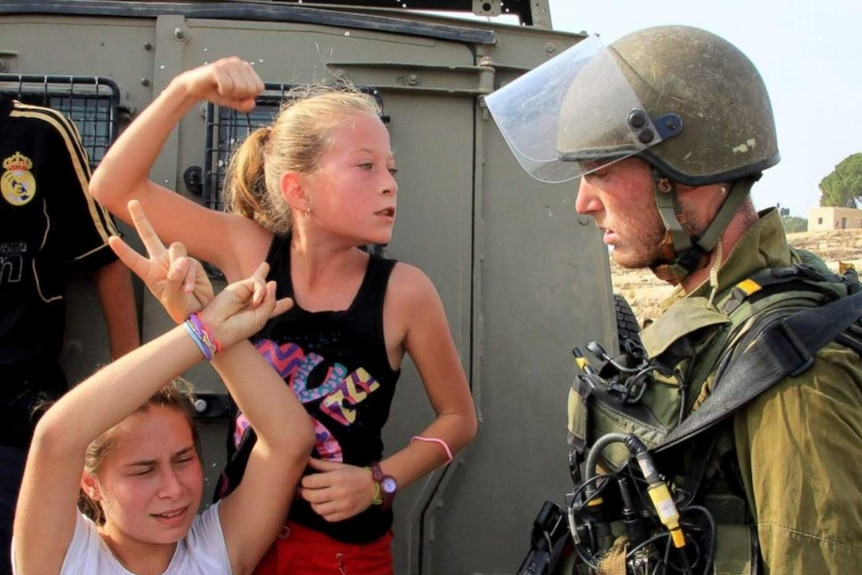 Ahed Tamimi at eight years old, brandishing a fist at an Israeli soldier.