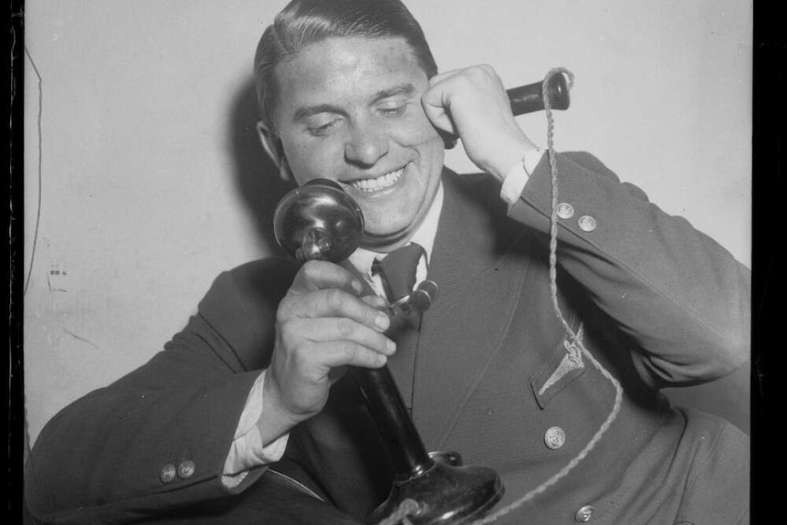 Aviator Captain Hans Bertram talking on the telephone, New South Wales, 26 October 1932.