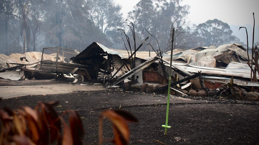 brick and tin houses collapsed after a fire