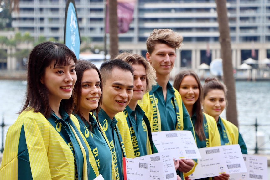 Group of diving athletes with their tickets to the Tokyo Olympic Games
