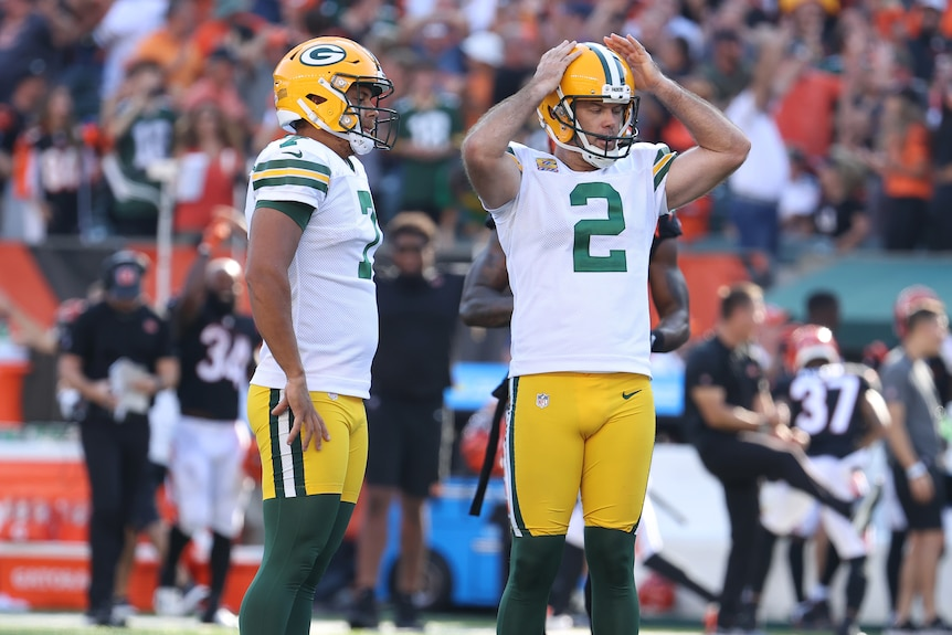 Mason Crosby stands with his hands on his head