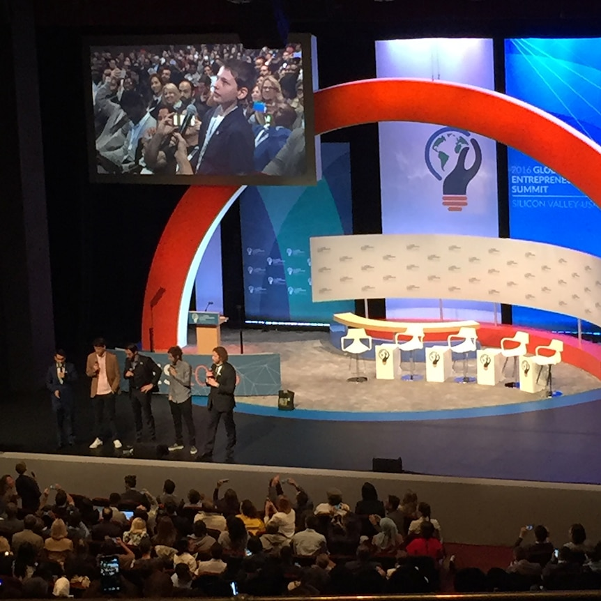 Hamish Finlayson appears on a screen above the stage at the global entrepreneurship summit 2016