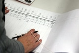A voter fills out a Senate ballot paper