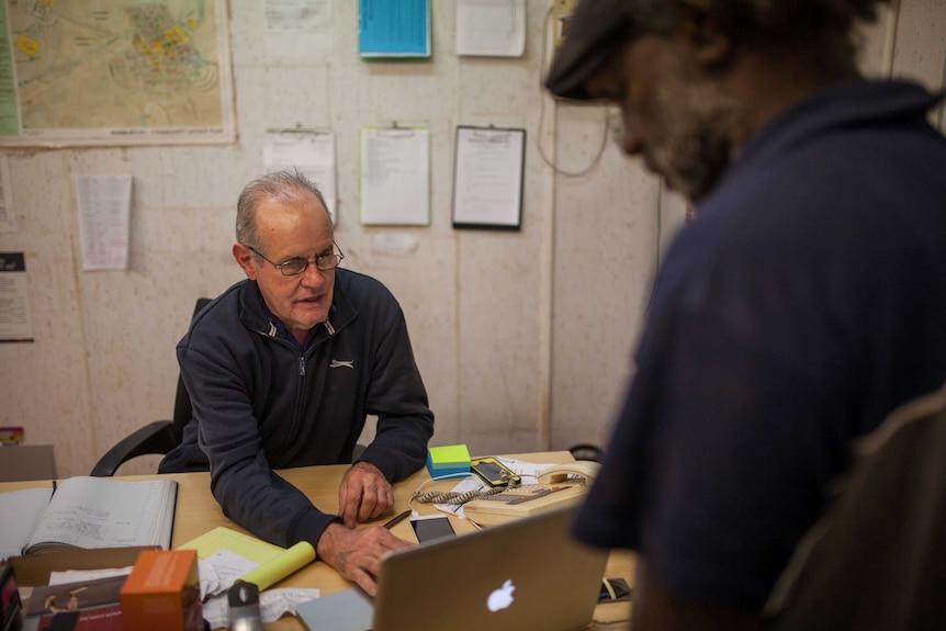 A Warburton Centrelink officer helps local man Dereck Harris with a Centrelink claim.