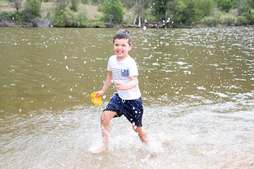 Five-year-old Jersey enjoys a splash at Kambah Pool