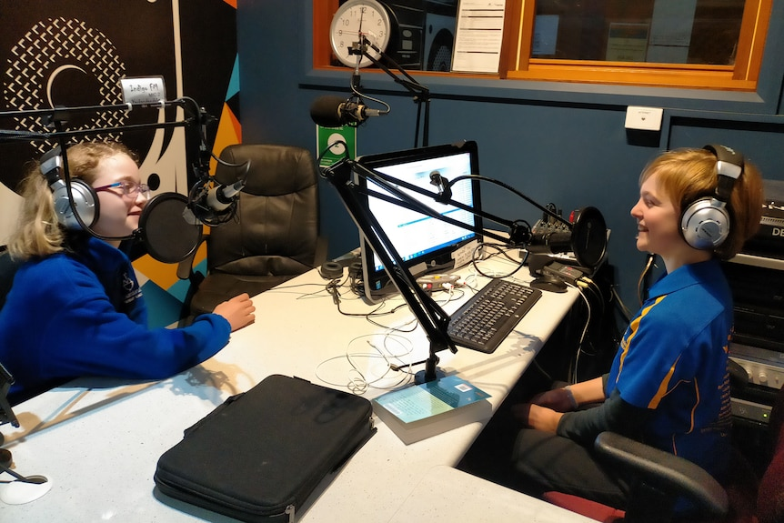 Ada Tracy and Irena Purnell sit opposite each other in radio studio.