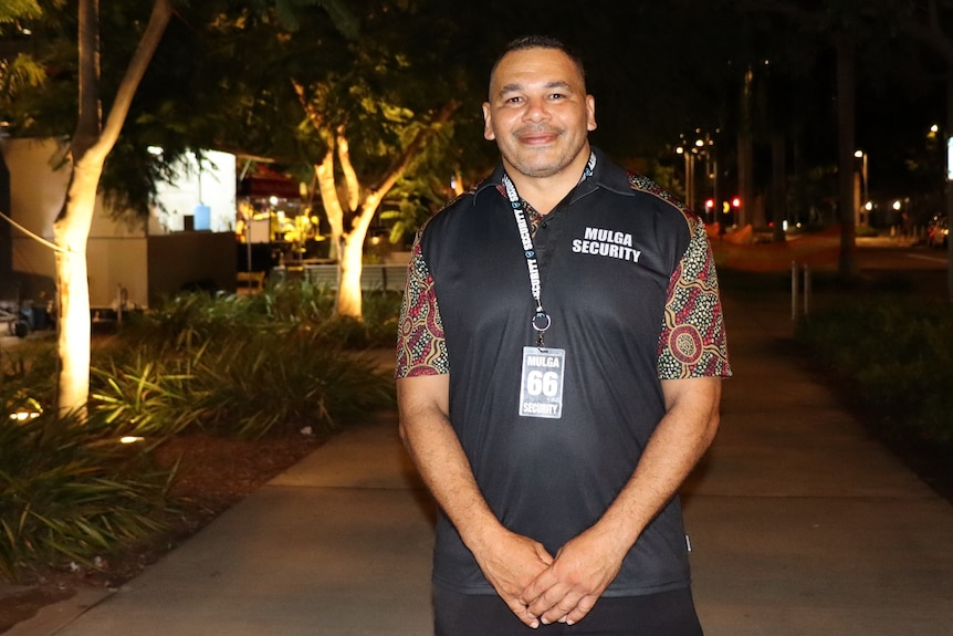 Shannon Brahim smiles at the camera on a Palmerston street in the evening.