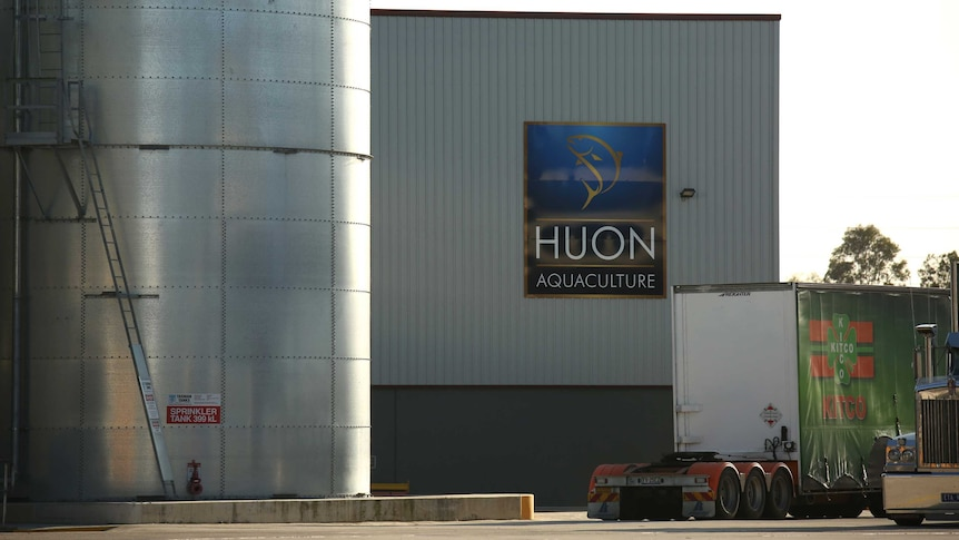 A factory with a sign saying Huon Aquaculture.