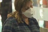 Passenger at airport wearing a mask