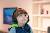 Child listening with headphones on.