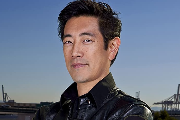 Mythbusters co-host Grant Imahara looks at the camera wearing a leather jacket