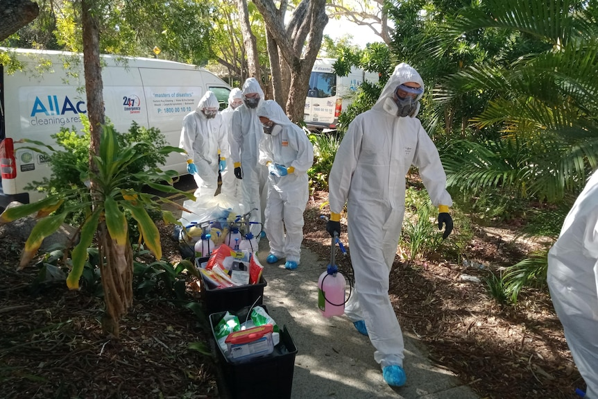 Deep cleaning crew arrive at Indooroopilly State High School in Brisbane on July 30, 2021.