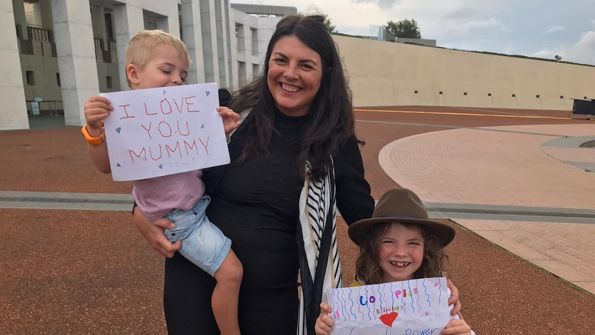 Samantha Payne and her children at parliament House celebrate new legislation on miscarriage laws