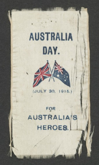 """A photo of a frayed ribbon that says """"Australia Day for Australia's Heroes""""."""