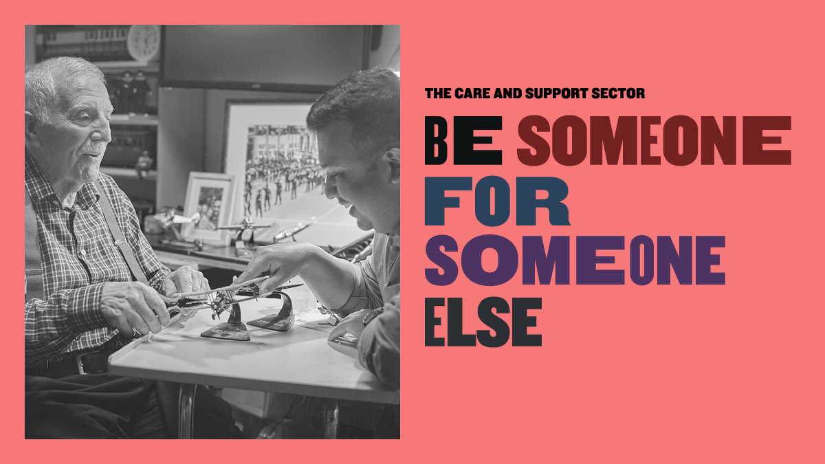 A black and white image of a young man and an old man playing chess next to the words 'be someone for someone else'.
