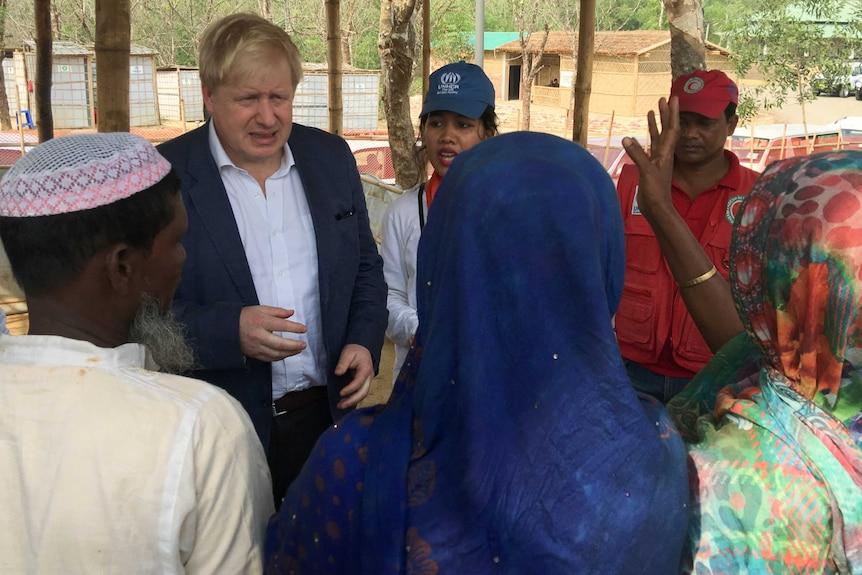 British Foreign Secretary Boris Johnson talks to Rohingya Muslim refugees from Myanmar at Kutapalong camp in Bangladesh.