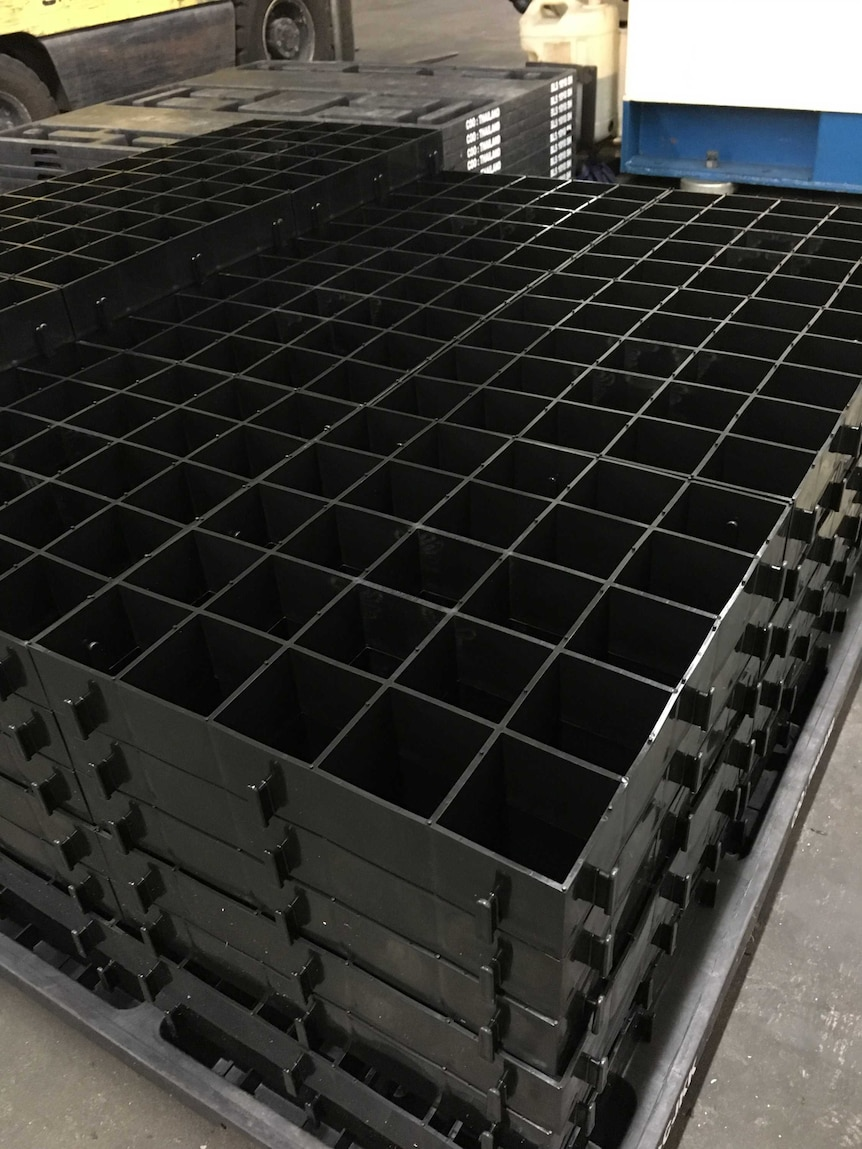 a stack of plastic grids