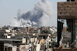 Smoke rises near the stadium where the Islamic State militants are holed up. The site was targeted in an air strike.