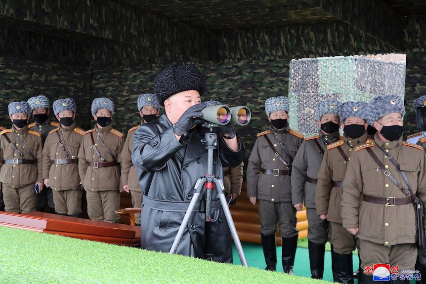 North Korean leader Kim Jong-un, centre, inspects the military drill of units of the Korean People's Army.