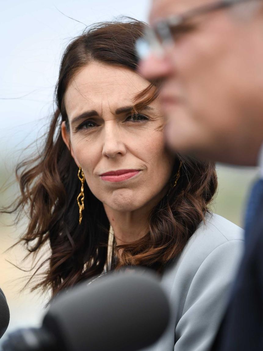 New Zealand Prime Minister Jacinda Ardern looks at Australian Prime Minister Scott Morrison.