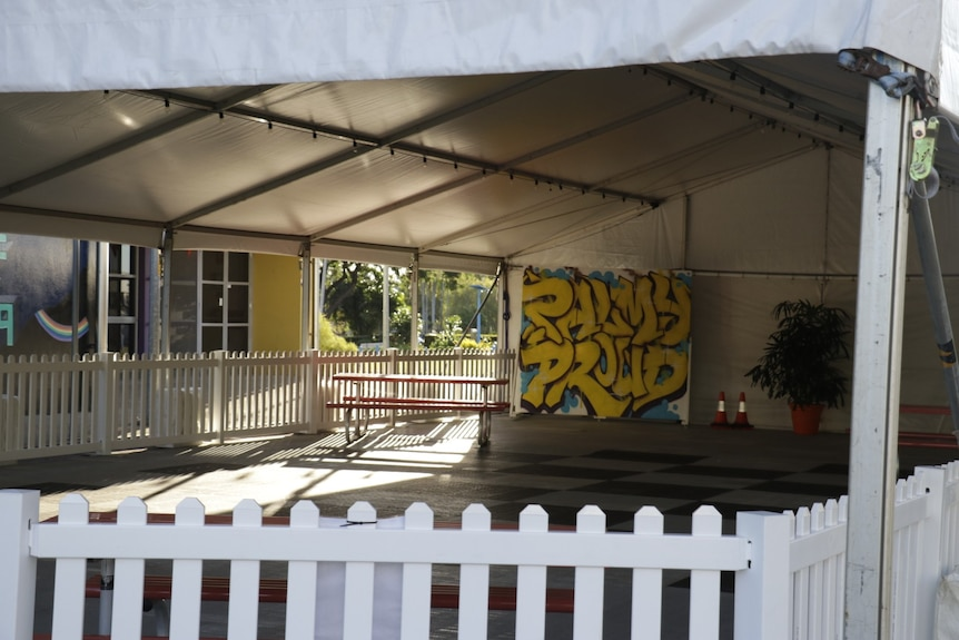 A public space in Palmerston is seen with 'Palmy proud' spray painted on the wall..