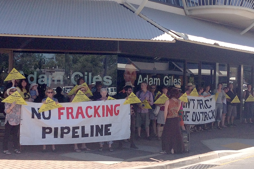 Protesters in Alice Springs rally outside the office of NT Chief Minister Adam Giles against a proposed gas pipeline.