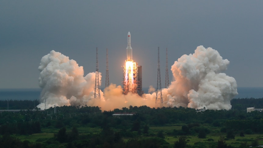 The Long March 5B rocket carrying a module for a Chinese space station takes off.