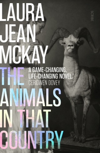 The book cover for The Animals in that Country by Laura Jean McKay with a woman and a goat